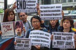 Activists stage a protest against the death sentence of Filipina Mary Jane Veloso, currently on death row in Indonesia after being convicted of drug trafficking, outside the Philippine consulate in Hong Kong on Wednesday. Veloso was caught at Yogyakarta airport with 2.6 kilograms of heroin in April 2010. Photo by Anthony Wallace, AFP